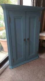 Blue painted wall corner cabinet