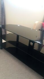 """T.V unit. black glass. excellent condition. would ssuit t.v up to 42"""""""