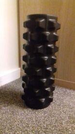 Black foam roller.