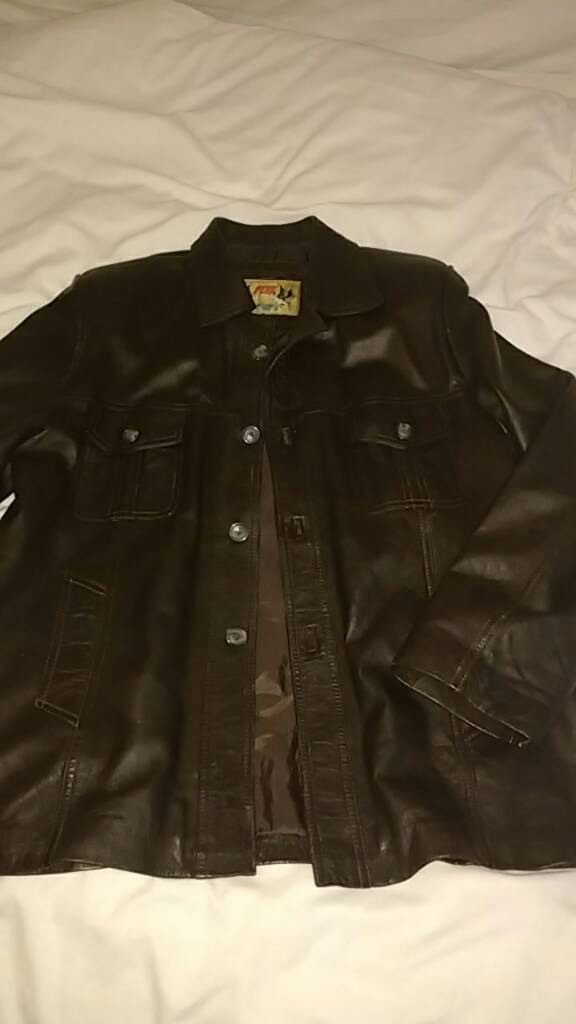 Retro brown leather jacket L/XLin Southside, GlasgowGumtree - Top quality morrocan leather. A couple of scuffs on both shoulders and one sleeve as I highlighted in the pics. Barely visible when worn and could be fixed if you can be bothered. Chest, length 80cm, sleeves 65cm