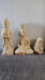 Standing Buddha, Sitting Buddha and young monk