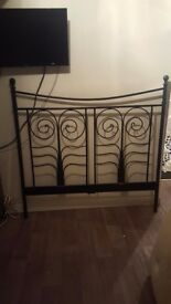 Black metal double bed frame with slots