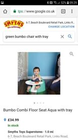 Green bumbo chair with tray