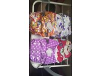 Reusable cloth nappies with inserts