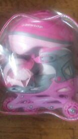 Dunlop Pink Girl's Roller skate set in rucksack with helmet and pads