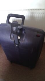 1x blue suitcase, hardcase with wheels [31x21x9 inch]. 1x green hardcase suitcase [31x21x9 inch]