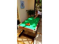 6ft Folding Pool Table in as new condition with 2x full sets of balls, 4x cues, triangles and chalk