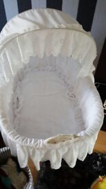 Large white Moses basket on wheels