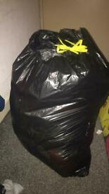Bin bag full of woman's clothing
