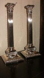 pair candle sticks.cornthian columns12inches high by ejkington,and co,rams heads bases,floral swags