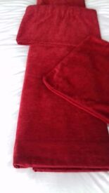 Pair of dark red pencil pleat curtains including pelmet and 4 matching cushion covers