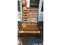 Refurbished wooden slatted rocking chair with cast iron ends