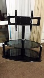 Black glass tv tables one with swivel arm