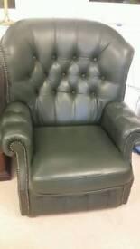 Two Green leather single seat sofa