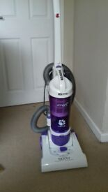 Upright Hoover Smart/Pets vacuum cleaner. Very good condition. Lightweight. No bags. Attachment.