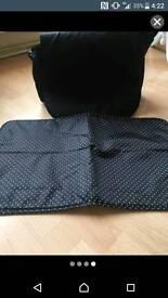 Black spotty pram bag with matching changing mat