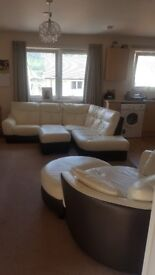 Cream leather corner sofa. With swivel chair
