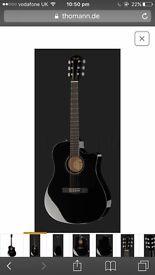 Fender semi acoustic black guitar and amplifier
