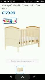 FREE - Cot bed babys r us cream oak trim