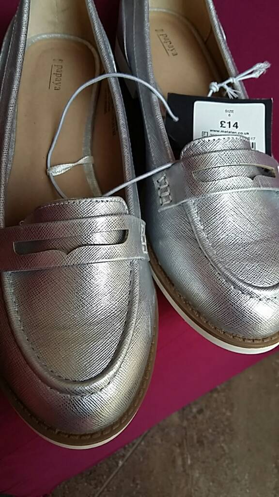Brand new silver coloured loafers