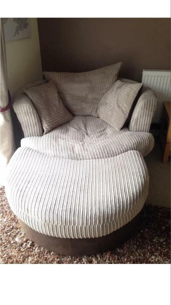 Brown and cream swivel sofa and footstool