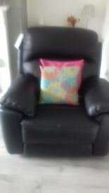 Black leather recling armchair as new