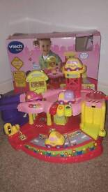 Toot toot garage in pink with 4 vehicles