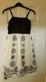 Party dress High School Musical black/white flowery 7-8 yrs and black furry cardigan