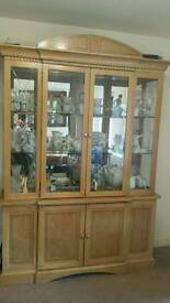 Excellent condition. Solid wood and glass cabinet