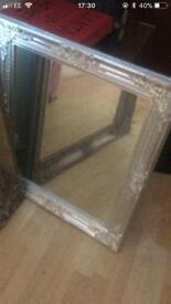 Silver ornate mirrors x 2