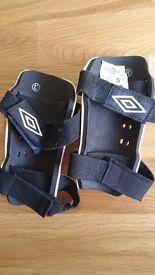 Umbro child's football boots (UK size 2/EU 34) & shin pads