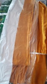 vibrant orange lounge curtaind fully linen dry cleaned