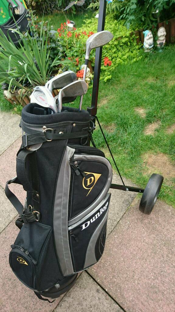 Dunlop golf bag with few clubs and Dunlop trolleyin Kitts Green, West MidlandsGumtree - Dunlop golf bag with stand and few Prodrive clubs and Dunlop foldable trolley. There is hole in one pocket.Used condition.txt me if cant answer your call Collection from Birmingham B33