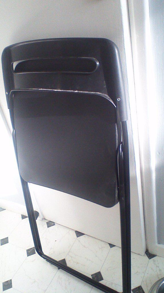 Two black folding chairs ikea great Xmas seating solution!