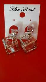 Silver ear rings brand new