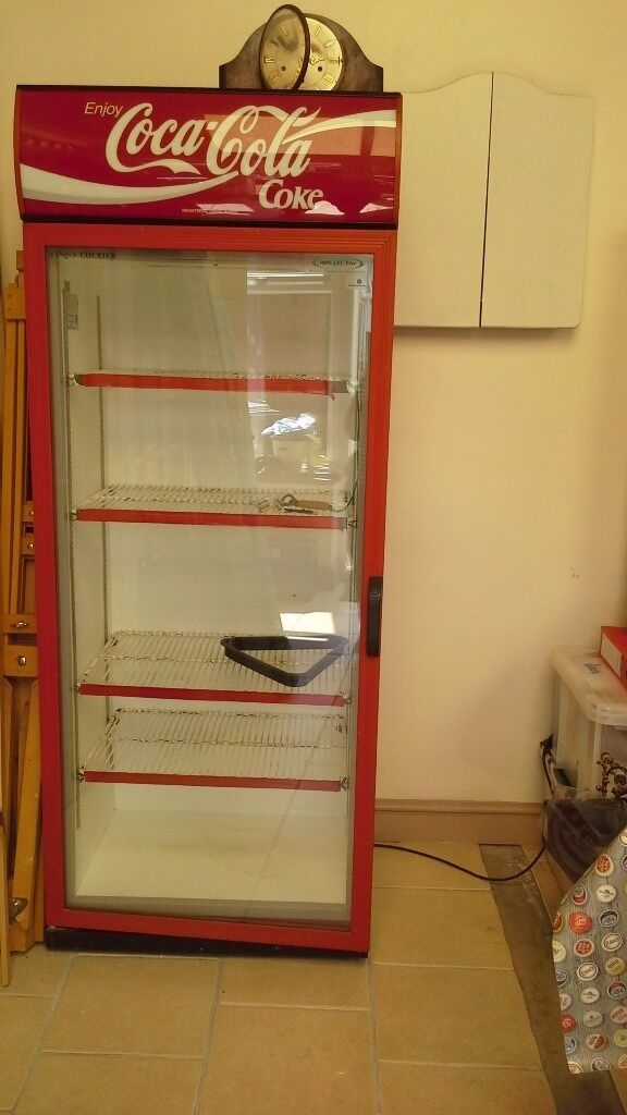 Large Coke a Cola fridge good working condition lights up needs shelving respraying