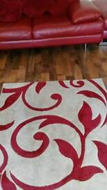 Red leather sofa 3 seater , 2 seater and large footstool