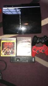 PS3 console and 2 games