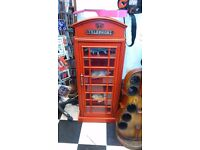 Red Telephone box with shelves