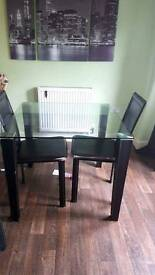 glass table with 2 leather chair