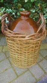 LARGE ANTIQUE GLAZED STONEWARE JUG/ JAR/ FLAGON OR POT FITTED IN A WICKER BASKET