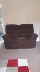 Two seater brown recliner couch