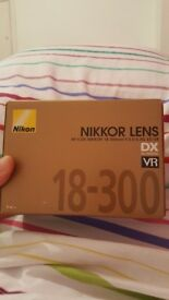 Brand new!! Nikon AF-S DX NIKKOR 18-300 mm f/3.5-6.3G ED VR Lens. Sealed!!