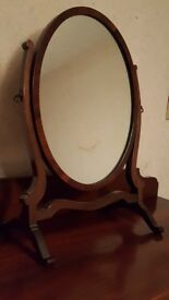 Antique oval mirror on stand