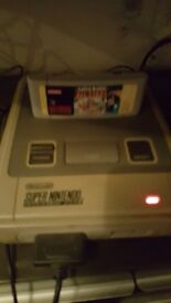 Super Nintendo with Super mario 1,2,3 and lost levels game!