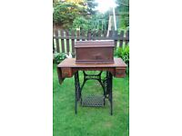 A Vintage Singer Antique Sewing Machine with table.