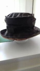 A ladies' Barbour wax water-repellant hat, size L, in very good condition ,in brown