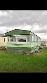 Static caravan two bed by the sea now reduced