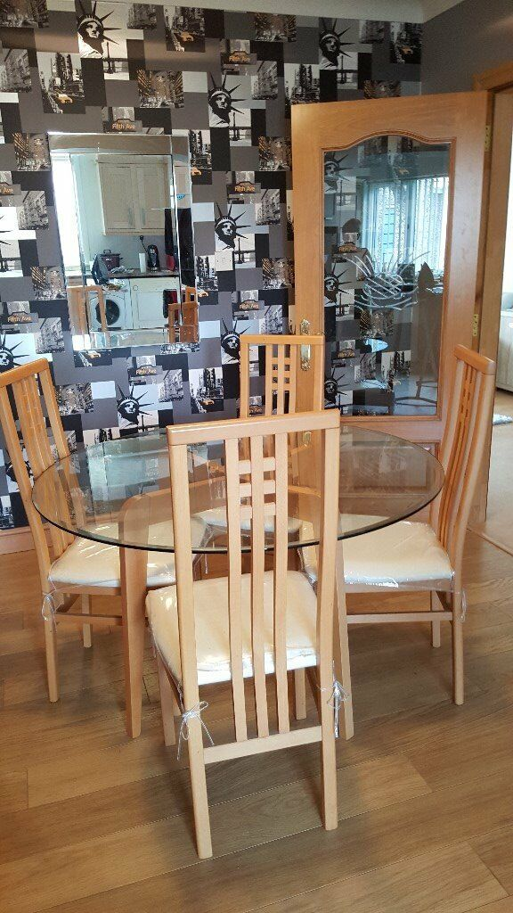 Dining set for sale excellent conditionin Cowdenbeath, FifeGumtree - Glass table wooden chair with cream seats all fitted with protective covers, originally sterling mills