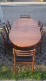very good quality/condition extendable dinning table and six chairs solid wood must be seen